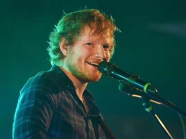 Ed Sheeran singing into microphone