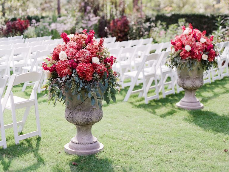 Eucalyptus and red hydrangea aisle decor