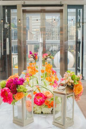 Elaborate Orange and Pink Floral Arrangement