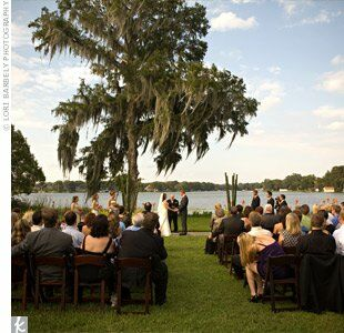 Vows were exchanged on a lawn by a lake. Lush Florida foliage provided the backdrop for the intimate spot.