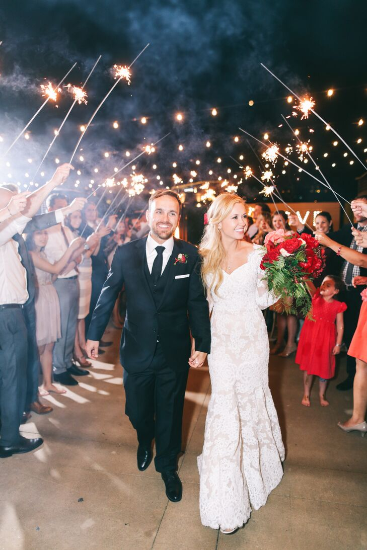"""""""We felt on top of the world as we walked under that sparkling canopy, seeing all the lit-up faces of the people we love,"""" Carlie says of her and Nate's grand exit."""