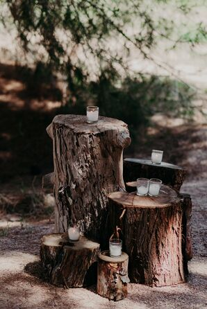 Rustic Tree Stumps Holding White Candles