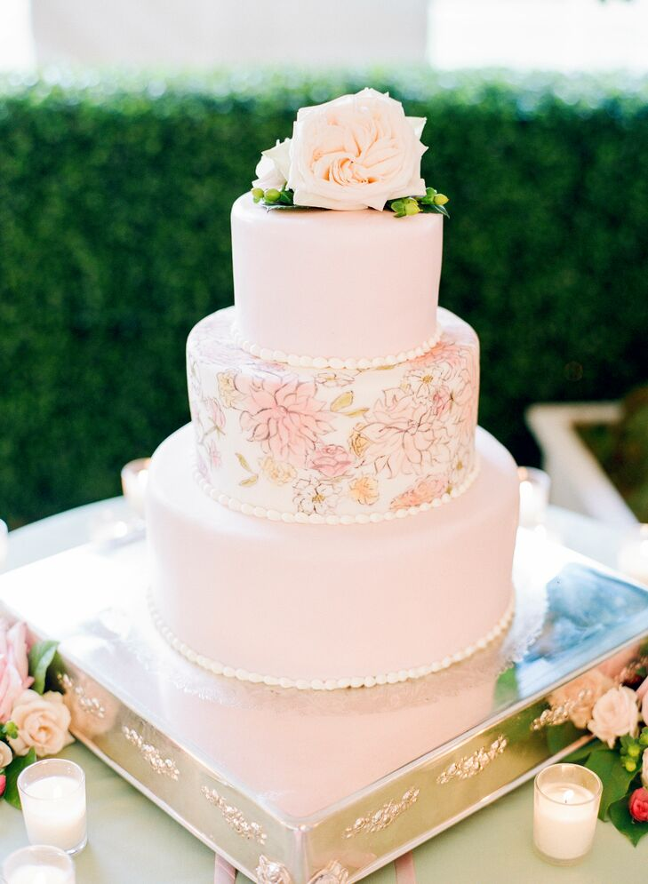 Two tiers of red velvet and another of coconut with strawberries were covered in light pink fondant and the same custom Inslee botanical watercolor design that was used on Kathryn and Ryan's invitation suite.