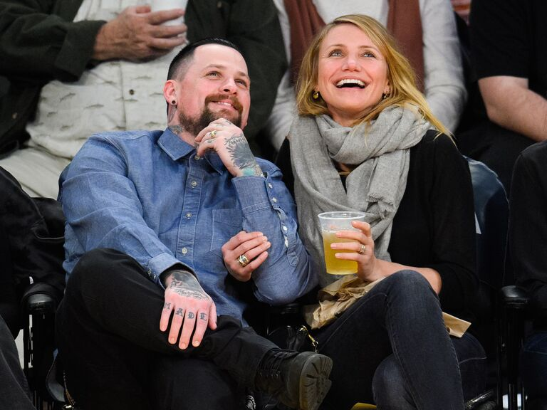 Cameron Diaz and Benji Madden pose together at an event