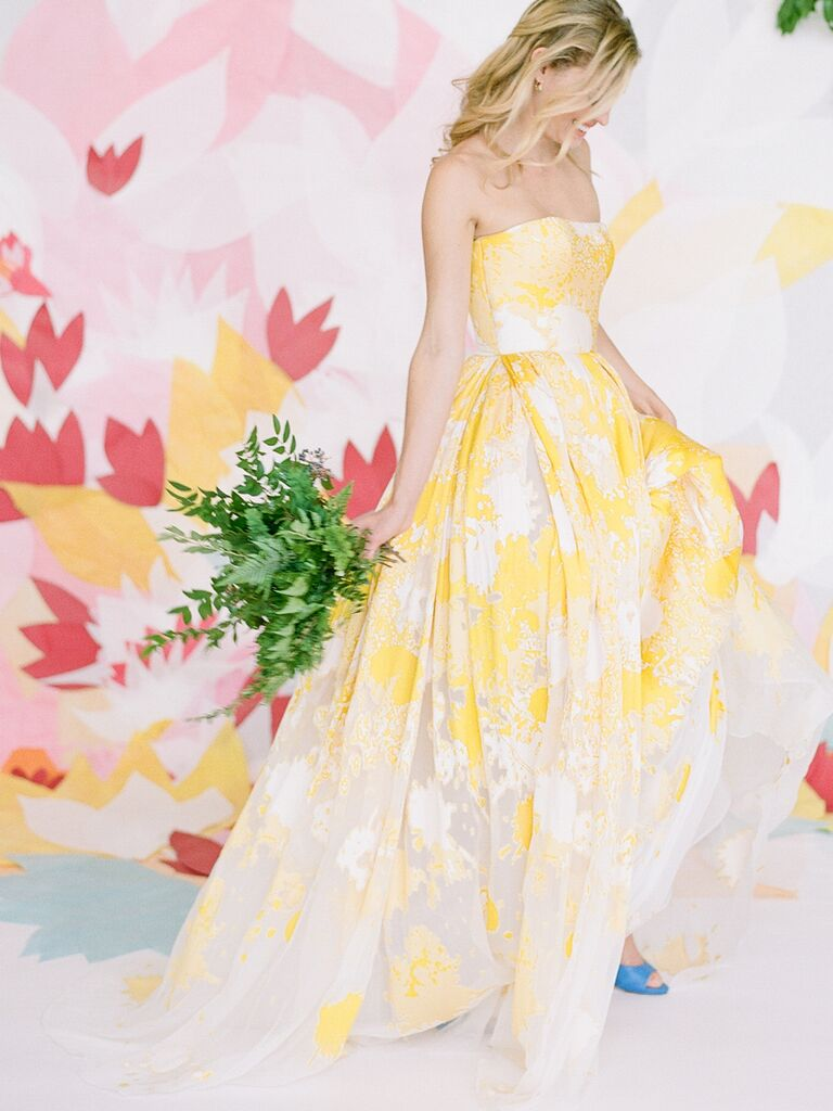 Strapless yellow and white Romona Keveza​ wedding gown