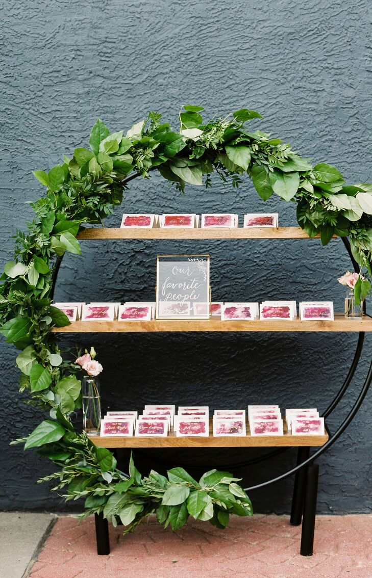 Circular Escort Card Display with Garland of Greenery