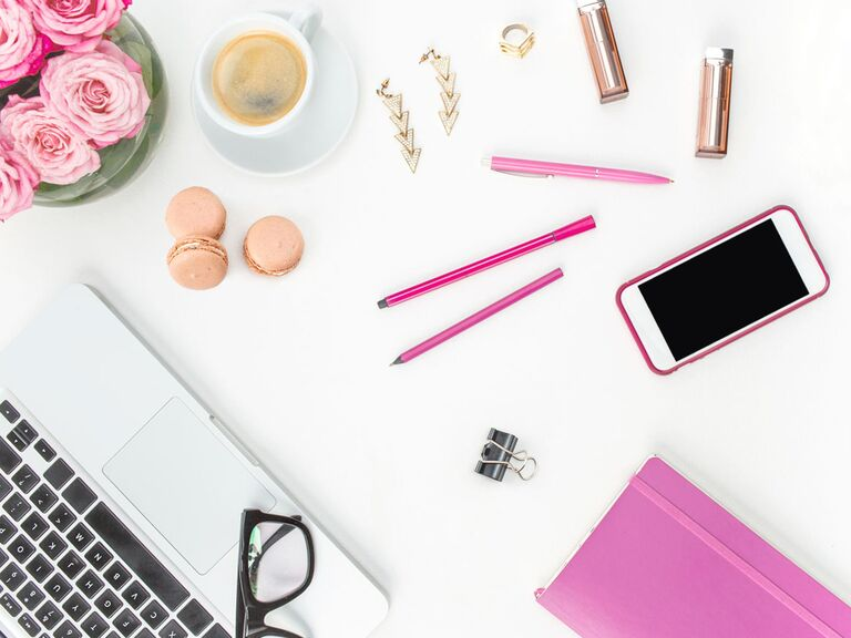 pink desk accessories with iPhone