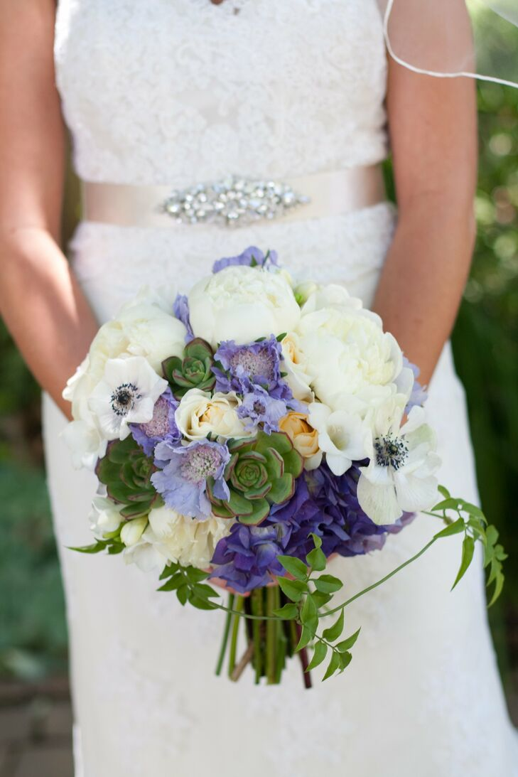 Jen mixed soft feminine peonies, scabiosa and anemones with bold succulents for an interesting textured bridal bouquet.