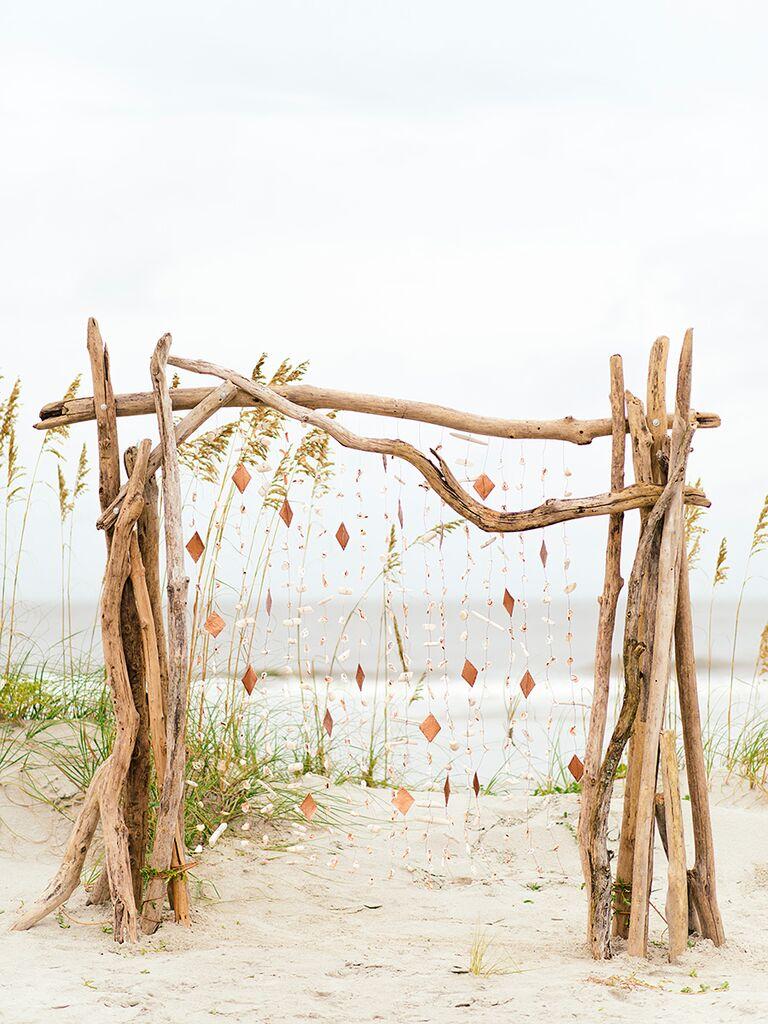 Beach wedding arbor idea with driftwood and seashells