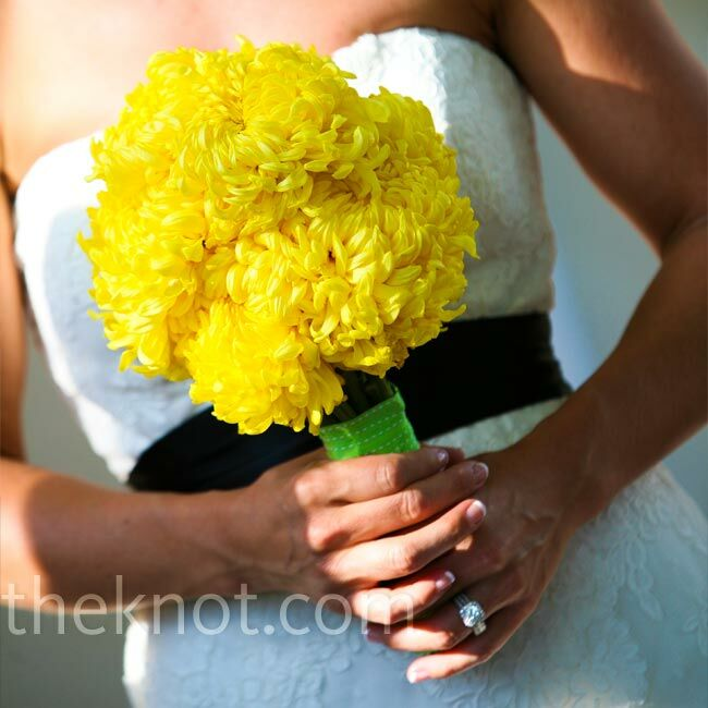 Andrea picked up bright-yellow chrysanthemums at the Los Angeles Flower District and wrapped them tightly together with green ribbon.