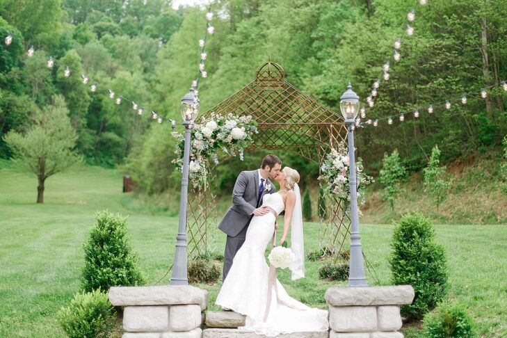 The wedding arch and bouquets included hydrangeas, Katharine's favorite flower. LB Floral added blue and pink flowers to create a natural, wildflower look.