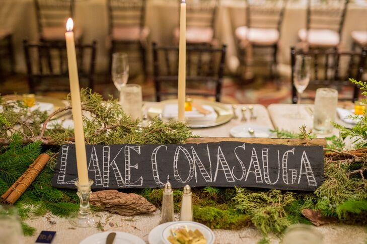 Rustic Table Name With Moss and Greenery