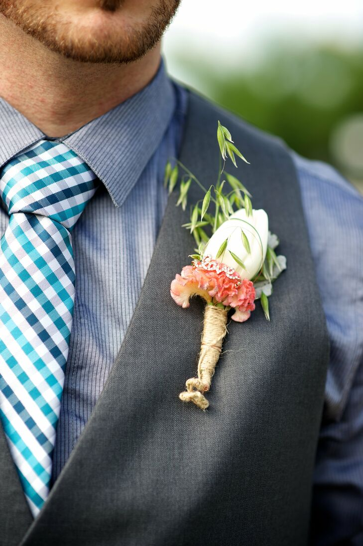 Marshall wore a white tulip boutonniere, accented with celosia and a tiny jeweled love charm.