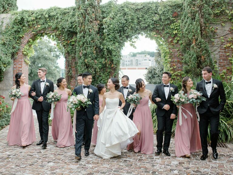 Bridesmaid picture with groomsmen at outdoor venue