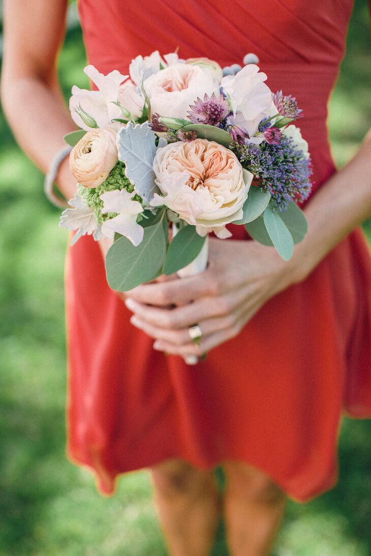 The bridesmaids wore Bill Levkoff persimmon chiffon dresses.