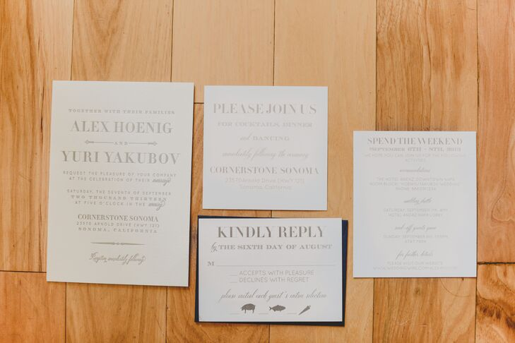 The wedding's color palette of grey, navy and white was incorporated into the invitations.