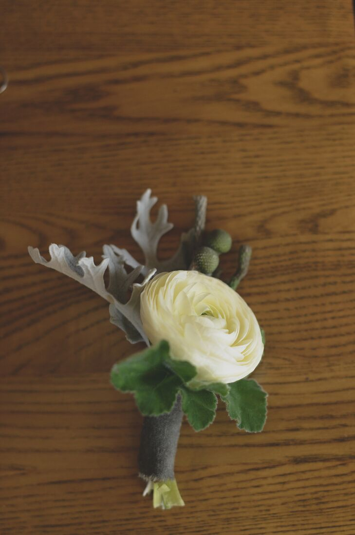 Yuri and his groomsmen each sported a white ranunculus boutonniere.