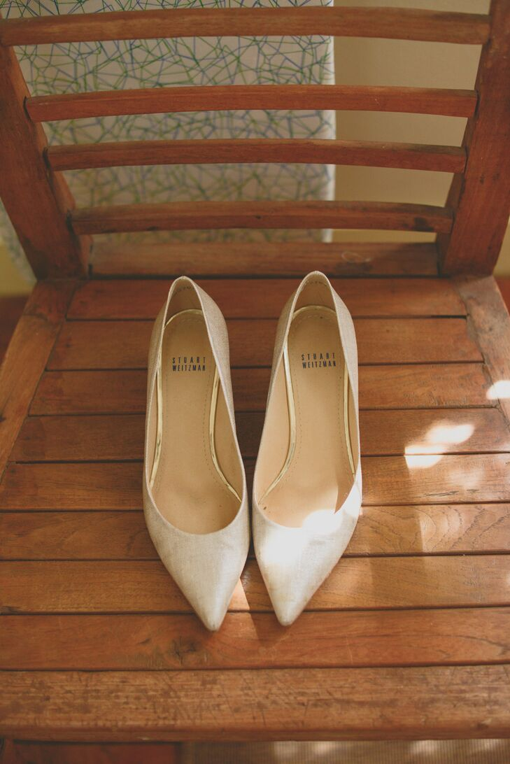 The bride wore Stuart Weitzman shoes which she purchased at a boutique across the street from her San Francisco apartment.