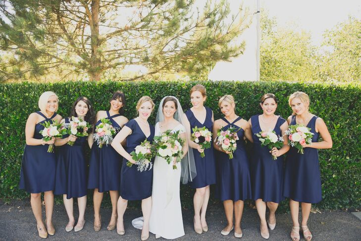 "Alex's bridesmaids donned knee-length navy dresses from J.Crew. ""I had them each pick out the silhouette they preferred in the same fabric,"" she says. ""It turned out that J.Crew was discontinuing the fabric I loved, so the line was on sale. Every dress was under $75 with shipping and alterations!"""