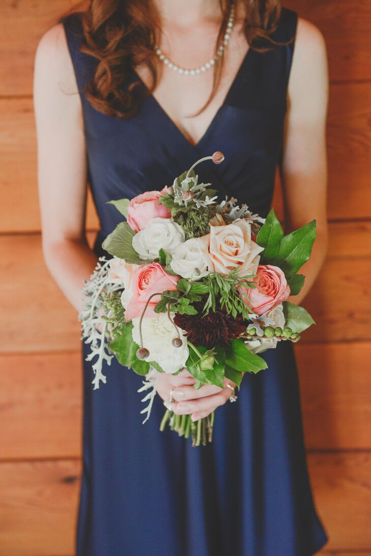 The couple's florist used a mixture of peonies, garden roses and ranunculus for both the bouquets and table arrangements.
