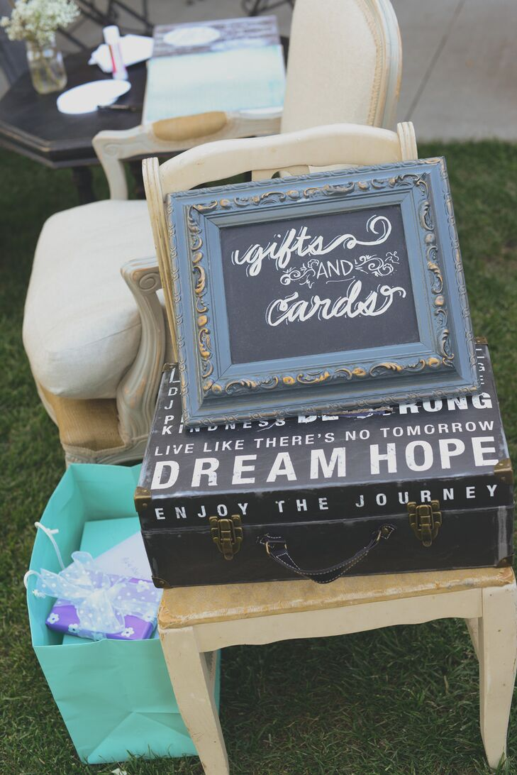 A vintage suitcase served as a box for guests to leave gifts and cards for the bride and groom.