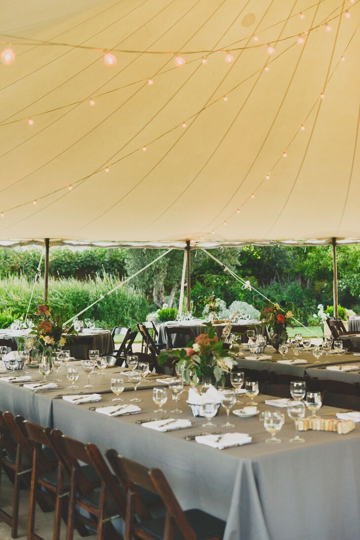 Grey tablecloths and white napkins covered the tables at the reception, where guests dined under string lights.