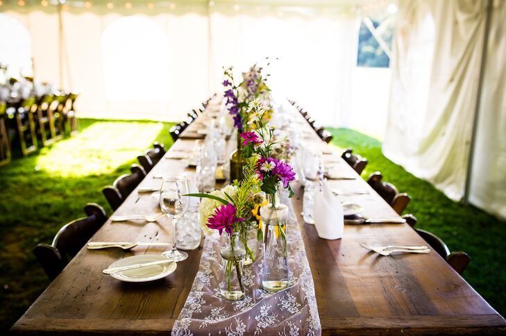Long wooden farm tables filled the outdoor tented reception space.