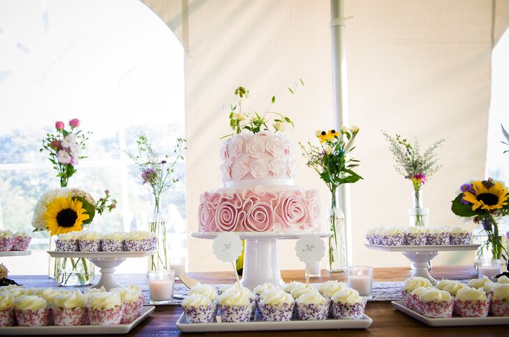 The tiered wedding cake sat in the center of the dessert table. The bush-hued cake resembled the bride's Vera Wang White gown.