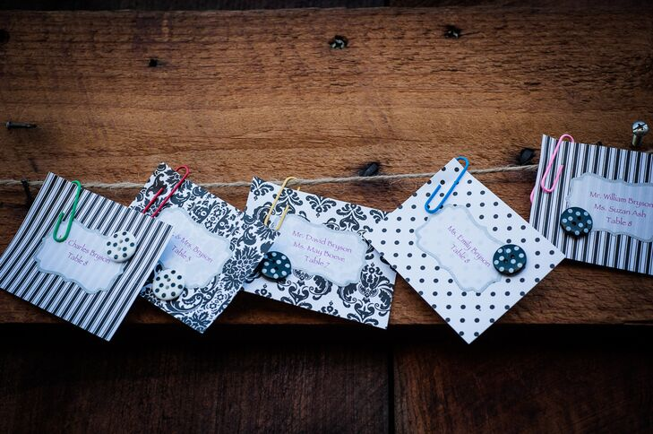 Guests found their names printed on escort cards made of various black and white patterned scrap book paper and adorned with buttons.