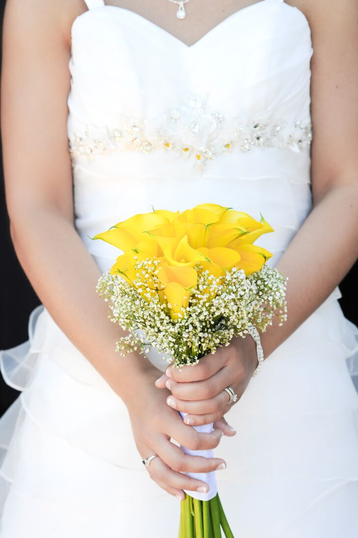 The bridal party carried small bouquets of bright yellow calla lilies with Baby's Breath.