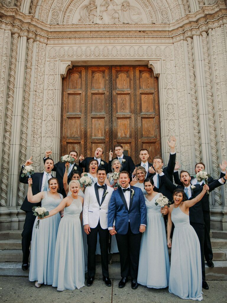 Grooms with wedding party outside ceremony site