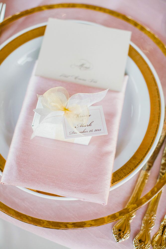 Pink satin linens covered the dinner menu and topped the gold-rimmed flatware at the reception.