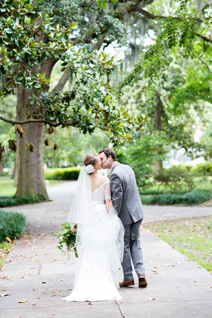 """There's no other time to wear a veil, so I knew I wanted a long veil,"" Faith says. She selected a sheer cathedral-length veil layered with a blusher, fastened with a white floral applique. She wore her hair in an updo, which allowed her to stay cool and comfortable in the Savannah, Georgia, heat."