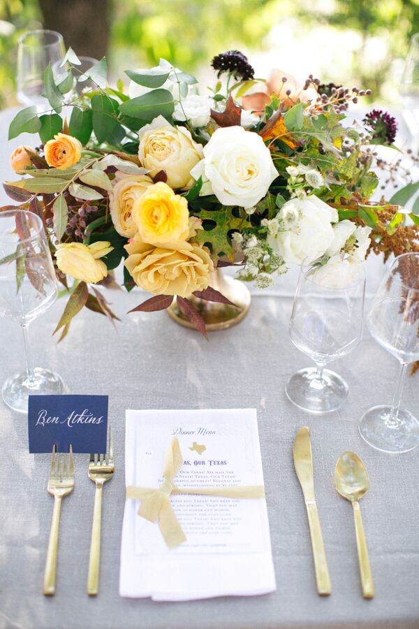 Place Setting with Gold Flatware and Grey Linens