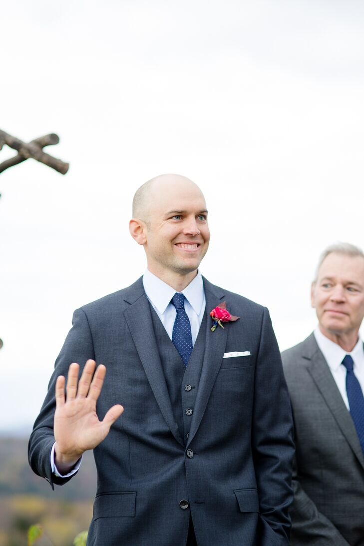 John was all smiles at the altar as he anxiously awaited Katie's arrival at the end of the aisle. Her offered an eager wave to his bride to be and her father as they processed.