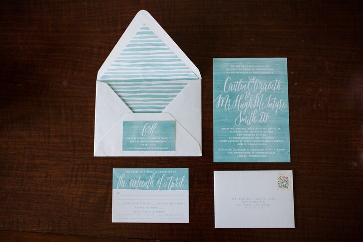 The reception decor might have been all-out Southern elegance with a garden-inspired twist, but Caitlin and Hugh took their stationery in a playful, modern direction. Jessica Stalnaker of Empress Stationery designed all the couple's paper goods, from the invitations to the escort cards and menus. She painted each element with a spectrum of blue watercolor paints and hand-lettered them with white.