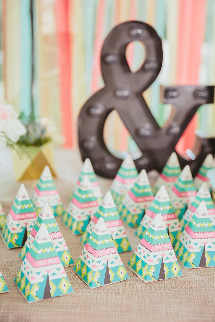 "Guests took home green, pink and white geometric-patterned boxes shaped like teepees, which had organic tea bags. Mai and Brian called the crafty gifts ""tea-pees."""