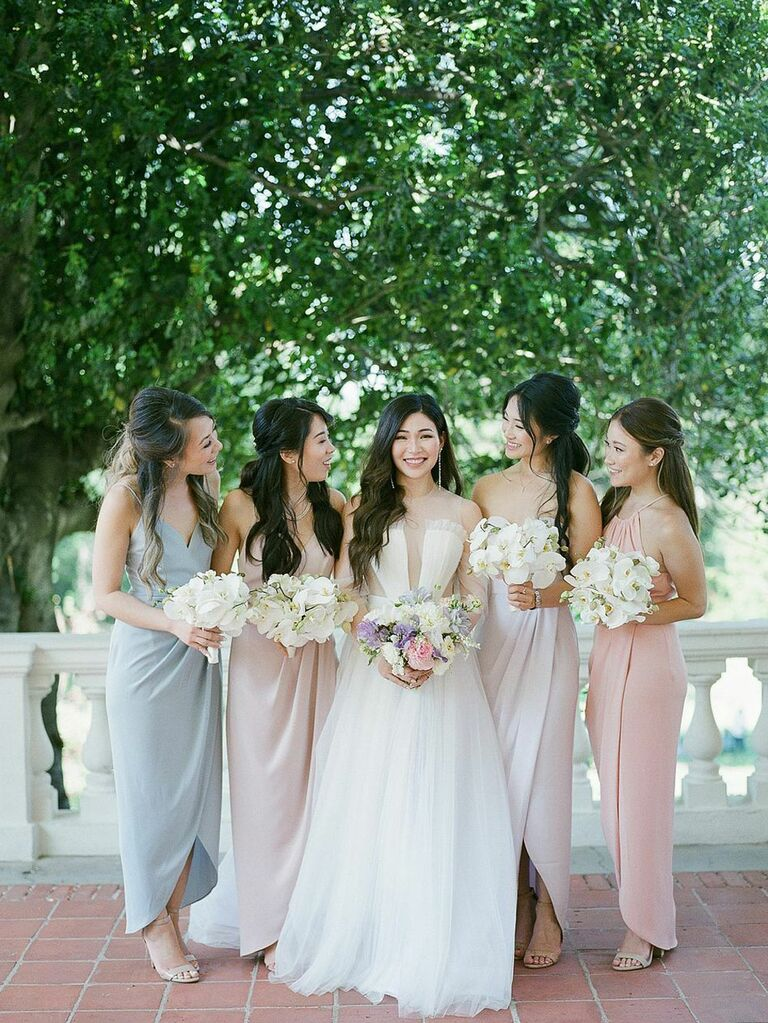 Bride with bridesmaids in summery pastel dresses