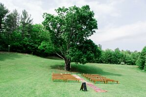 Simple Outdoor Ceremony Site with Rug Aisle Decorations at Allrose Farm in Greenfield, New Hampshire