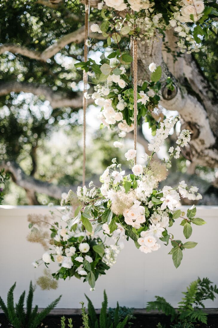 White Floral Arrangements Suspended With Rope