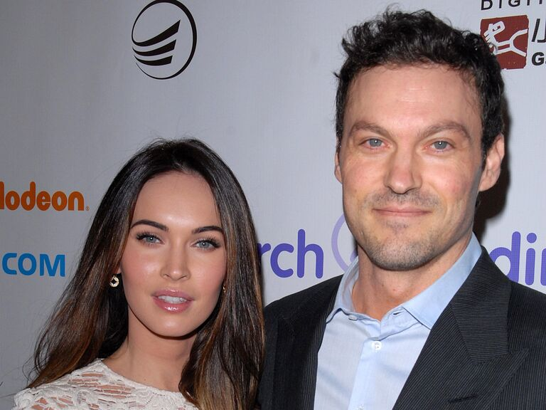 Megan Fox and Brian Austin Green pose together at an event