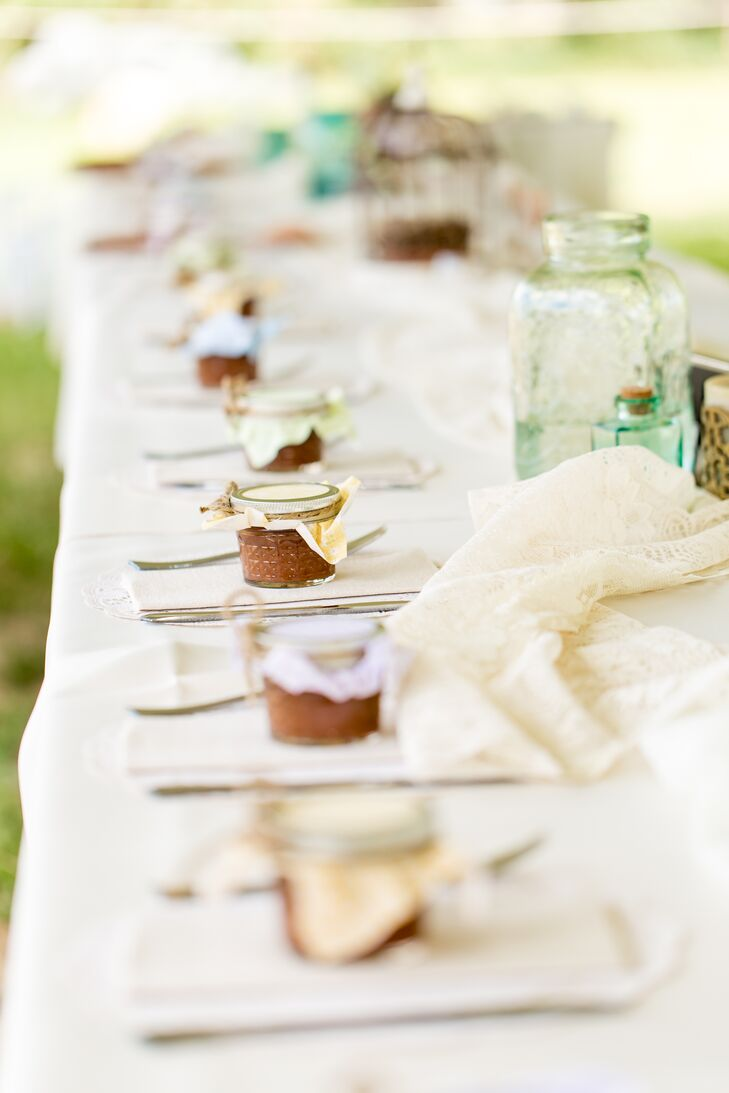 For wedding favors, Leslie's mother, sisters and friends helped make 234 jars of homemade apple butter. They used apples from Ya Ya Farm & Orchard in Longmont, Colorado. Leslie and Andrew loved how the gifts were homemade, incorporated the rustic theme and a piece of their romantic venue.