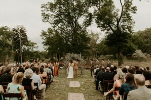 Bohemian Ceremony with Wildflower Arch and Rug Aisle Runners
