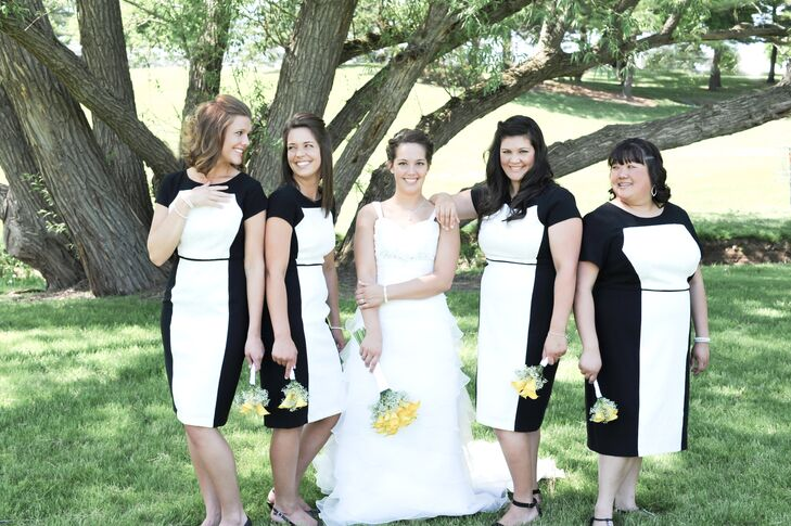 The bridesmaids wore black and white modern dresses.