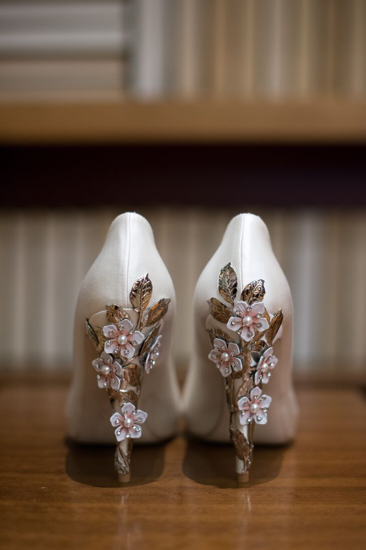 """""""My shoes were some of the most beautiful ones I've ever owned,"""" Marisa says. """"They had metallic cherry blossoms going down the heels that covered the cream silk of the rest of the shoe."""" She also brought a pair of sneakers, which were a must-have for the reception."""