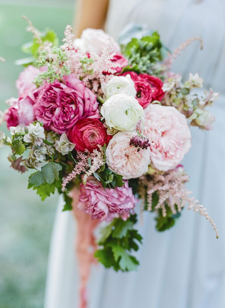 Ranunculuses, garden roses and astilbe in various shades of pink filled the bridesmaids' bouquets. The bright bouquets popped against the muted shades of their gowns.