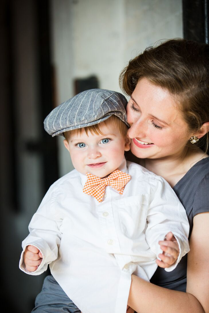 The ring bearer donned a newsboy hat, white shirt and slacks from Target. He completed his look with an orange bow tie from Neiman Marcus. Since he was too young to walk down the aisle, his parents, both part of the wedding party, pulled him in a little wagon behind them.
