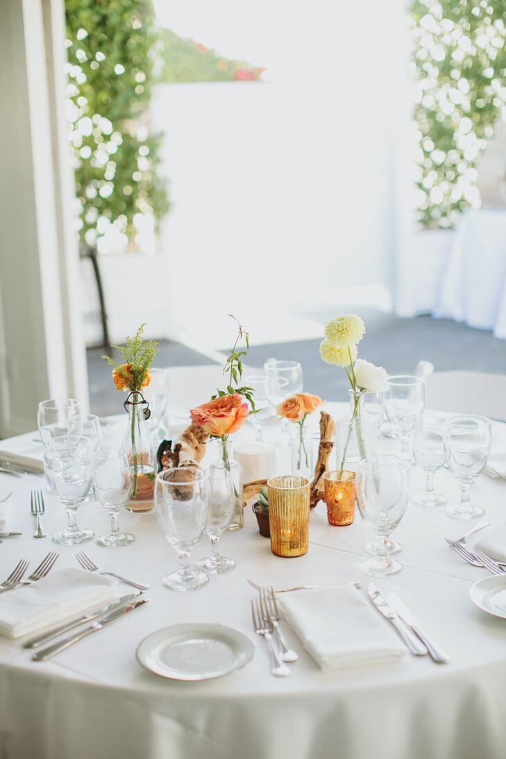 """Our reception decor had more of a desert-boho vibe,"" Gwynne says. ""It was an eclectic combination of vintage bud vases and olive wood branches with copper and gold votives."""