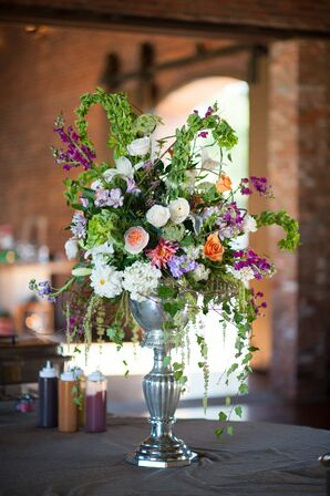 Whimsical Vibrant Floral Centerpiece in Silver Urn
