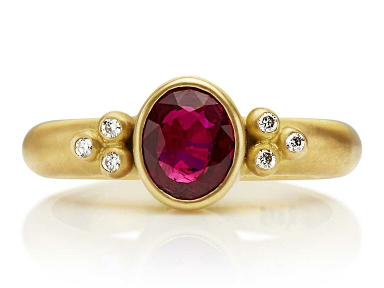 Bezel set ruby engagement ring with chunky gold band